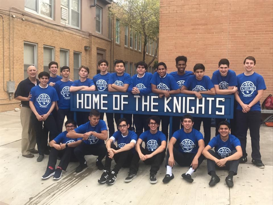 Students at the Home of the Knights sign