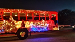 school bus covered in Christmas lights