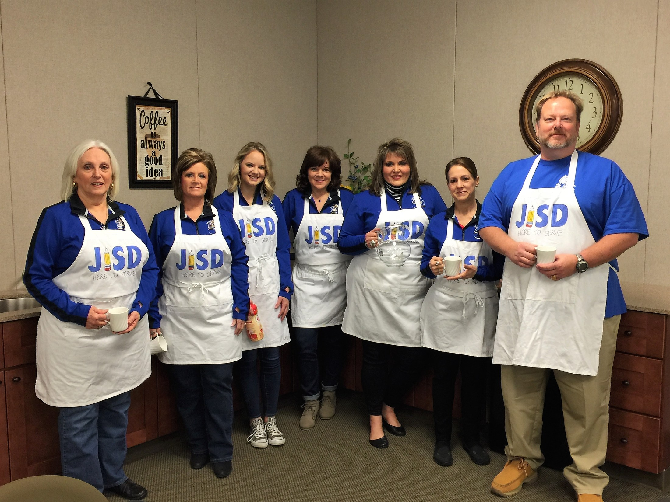Business Office staff members in aprons
