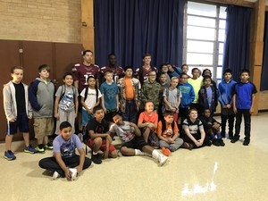 Group of students with 3 football players