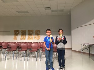 Spanish Spelling Bee Winners with trophies