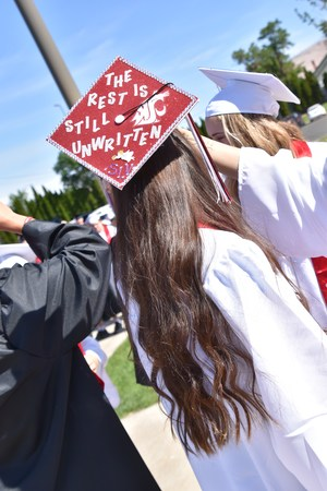 Senior with a Cap that says,