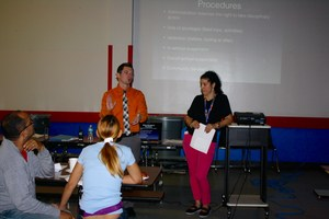 Mr. Bonacci, Dean, and the social worker talking to parents about cell phone usage