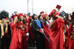 Sierra Vista High School's graduating class of 2017 erupts with howls and cheers after they flip their tassels, signaling the end of their high school careers, during the school's graduation ceremony on June 1.