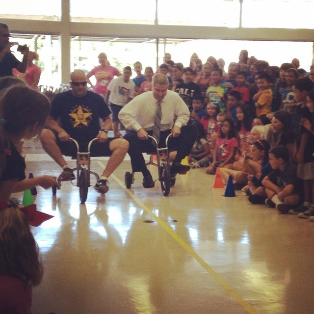 Dr. Blackwell competing in a tricycle race