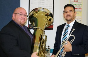 Two band directors holding instruments.
