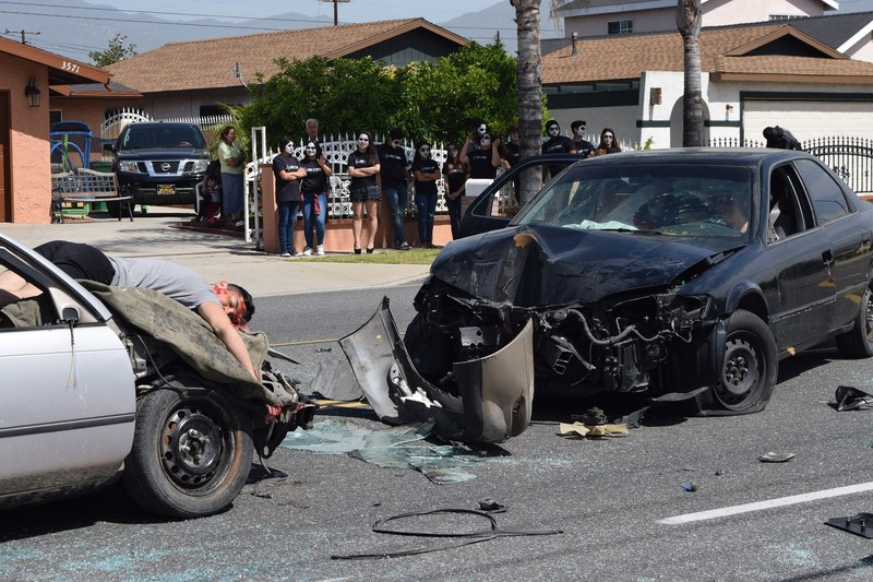 """Sierra Vista High School kicked off an """"Every 15 Minutes"""" two-day program on April 26 with a simulated drunk car crash involving student participants and Baldwin Park emergency medical and law enforcement responders. Selected students were taken from class by the Grim Reaper and given face makeup to represent lives lost to alcohol-related crashes."""