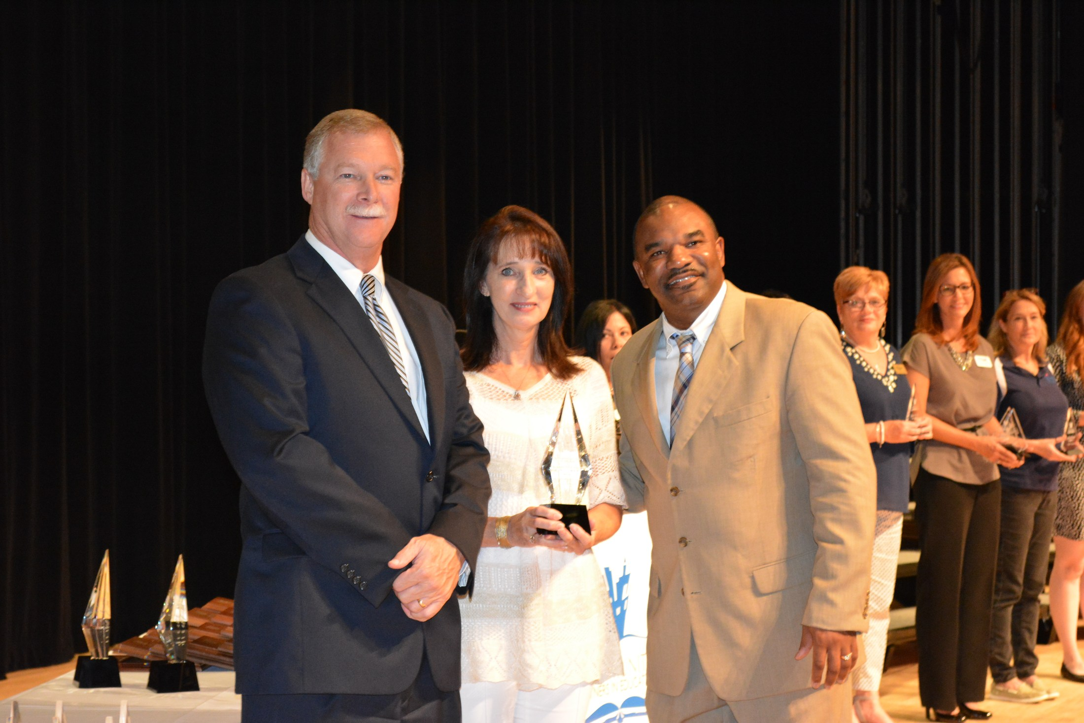 Superintendents pose with award winner