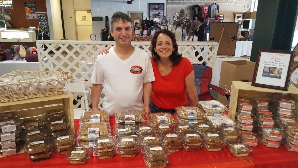 Man and woman selling baked goods
