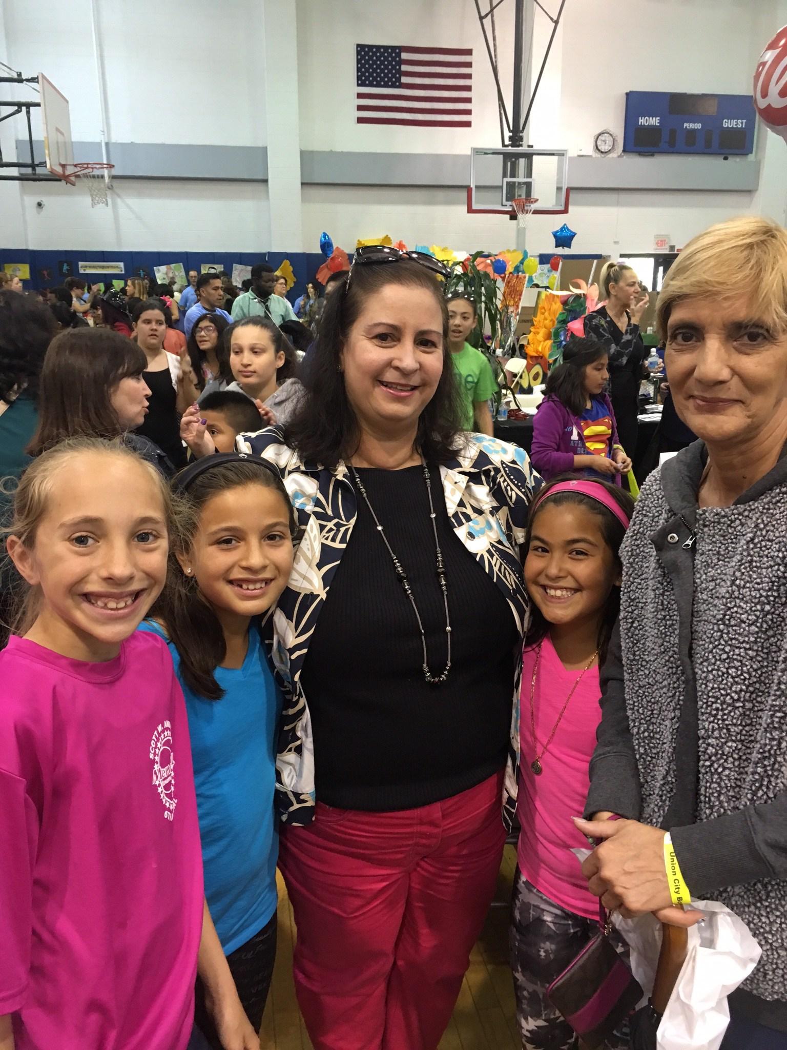 Superintendent Silvia Abbato hugging children at the Union City Health Fair