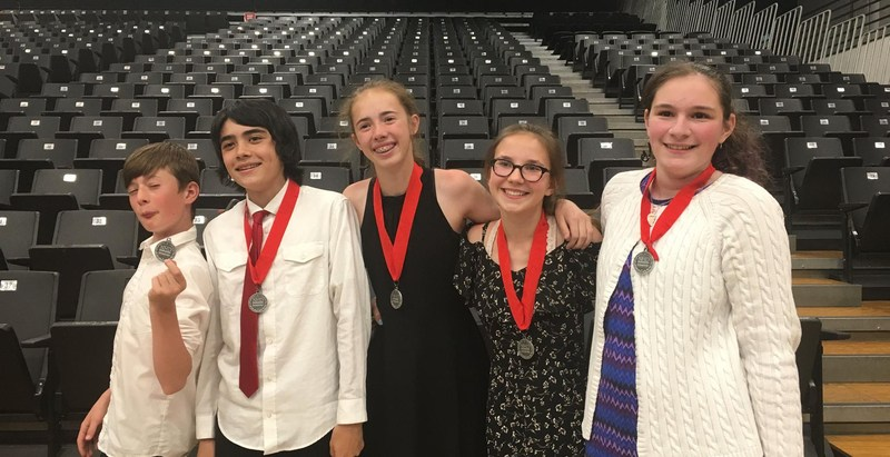 Students display their medals at National History Day.