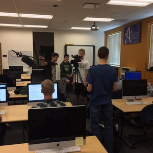 Broadcasting students filming an interview.