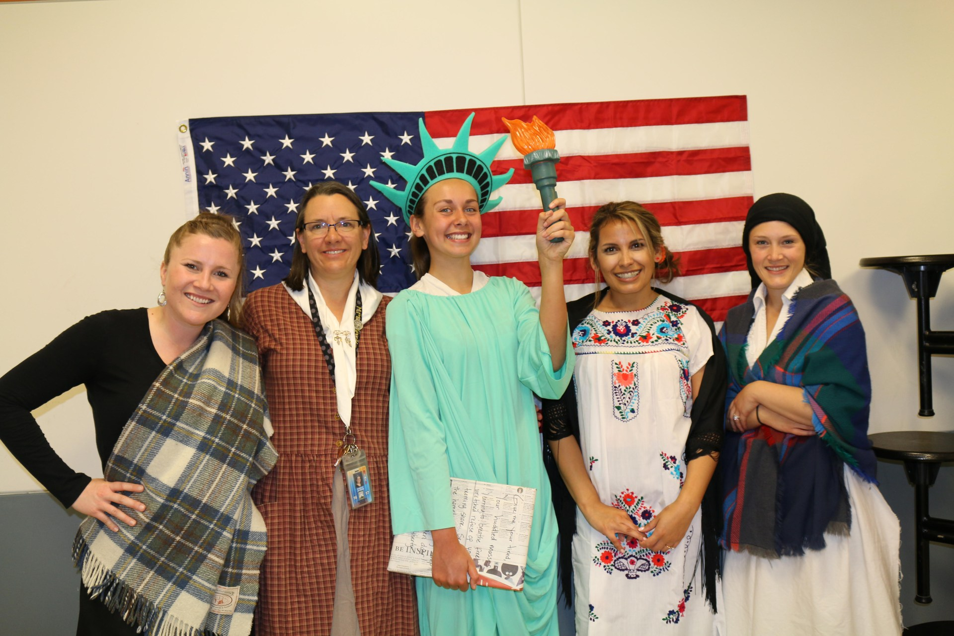 Picture of four second grade teachers and a student Statue of Liberty on Ellis Island Day