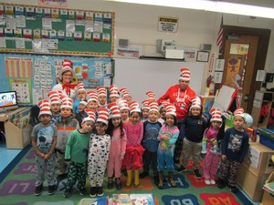 Younger kids wearing their cat in the hat, hats