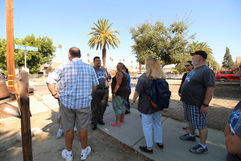 Rancho Viejo staff walking throughout a neighborhood.