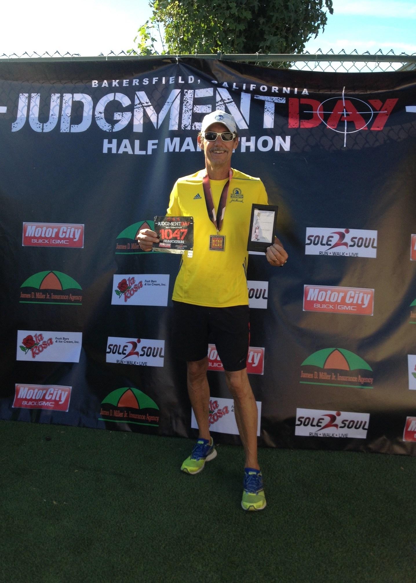 Holding first place half marathon award