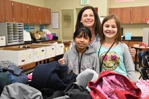 Mrs. Baldwin working on clothing sorting with two of her math intervention students.