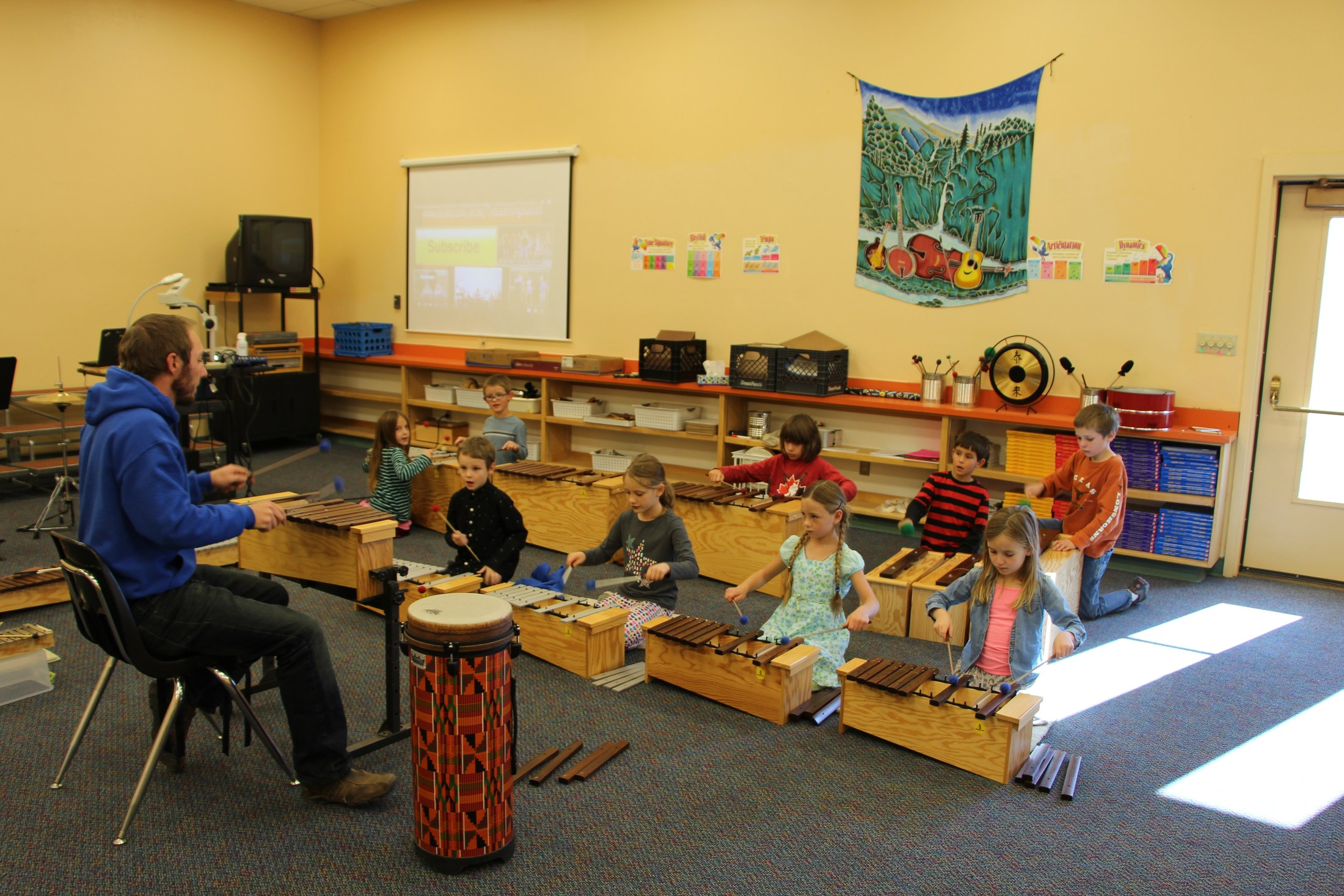 Students play xylophones in music class.