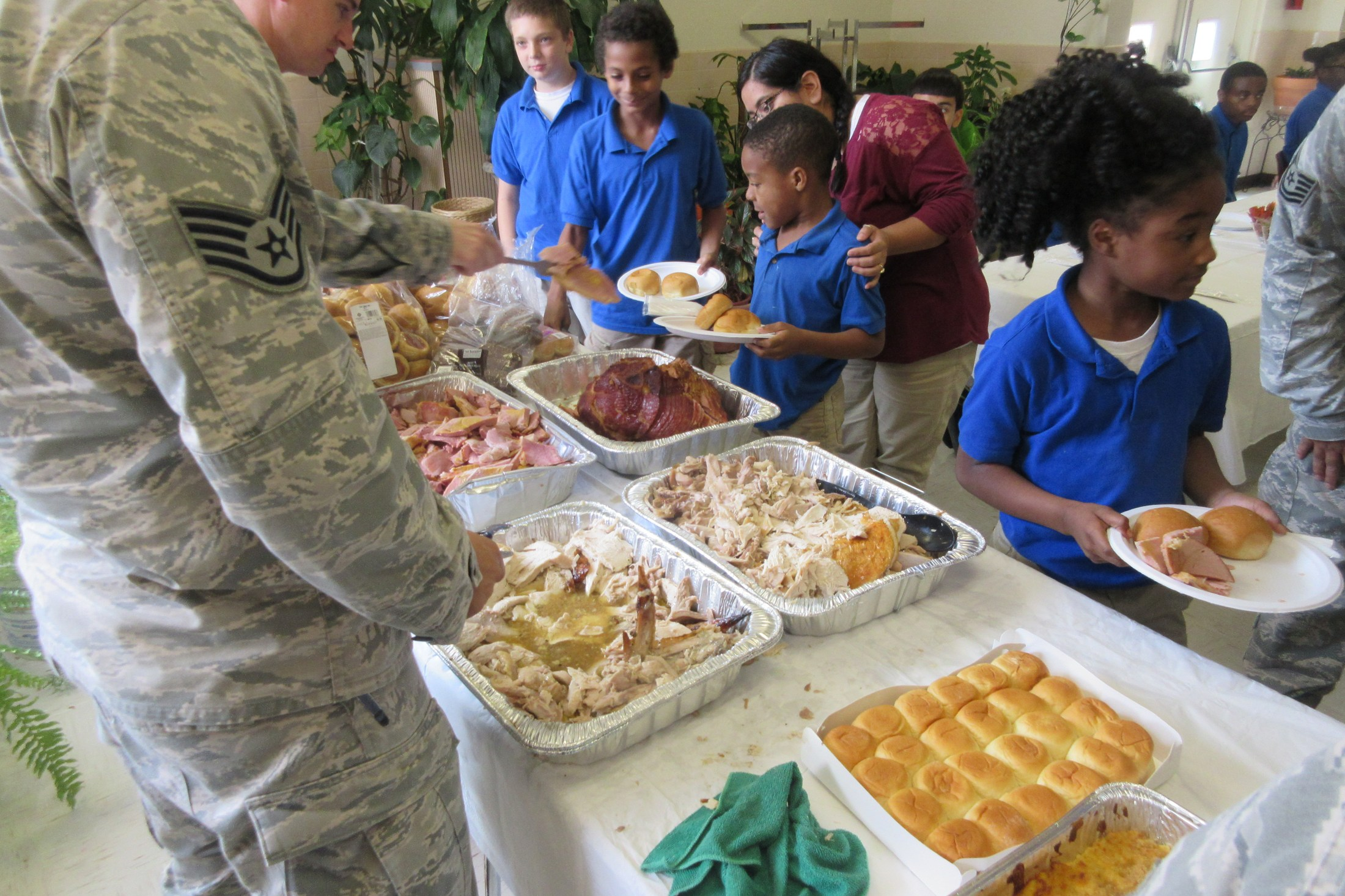 Airmen serving students