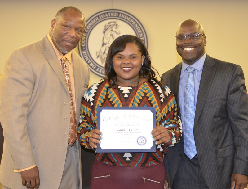 Middle School Star student with principal and superintendent