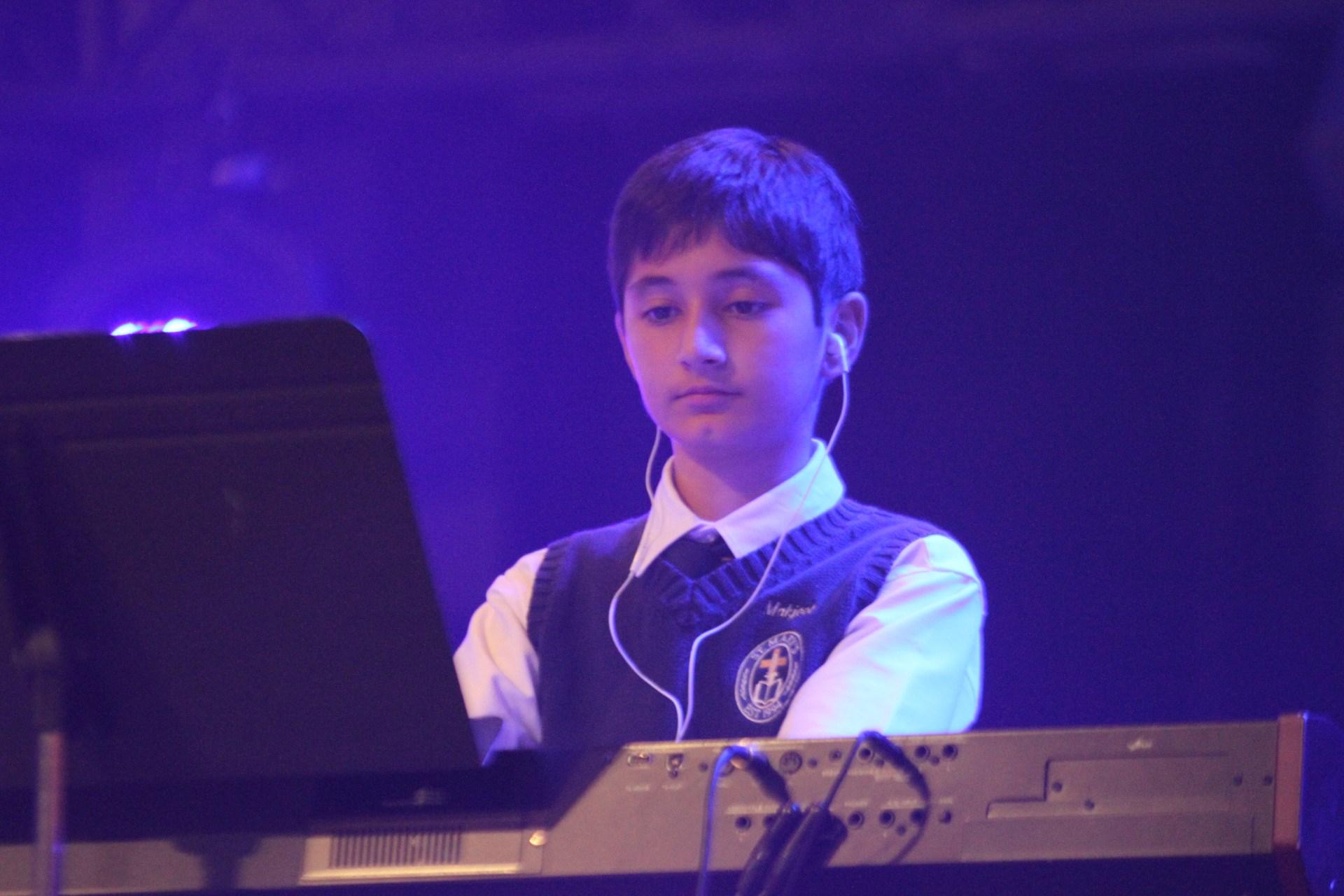 boy playing keyboard