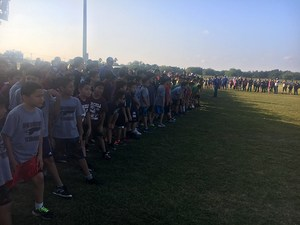 starting line for cross country event with elementary students ready to run