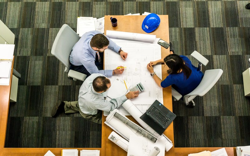Aerial image of people working together around a table