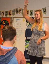 "New Thornapple Kellogg High School Spanish teacher Melissa Doran plays ""Simon Says"" in Spanish to teach the students new vocabulary words."