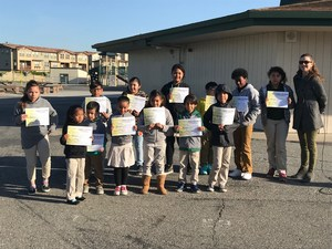 students posing with student of the month certificates