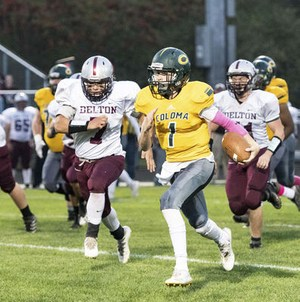 Coloma quarterback Zach Goodline carries the ball on October 13, 2017 in a game against Delton-Kellogg.