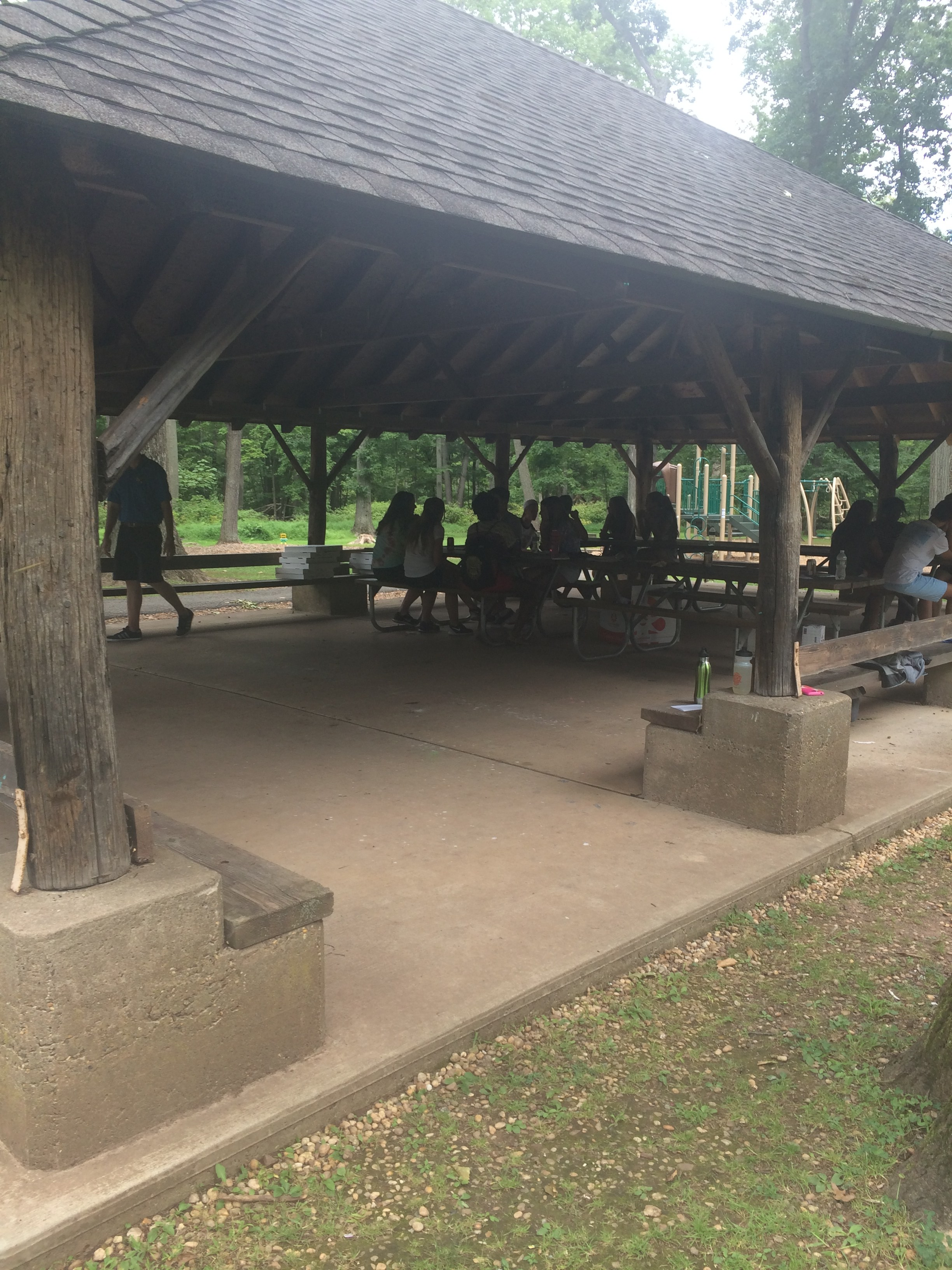 Student Council meets under a park picnic shelter during its working retreat