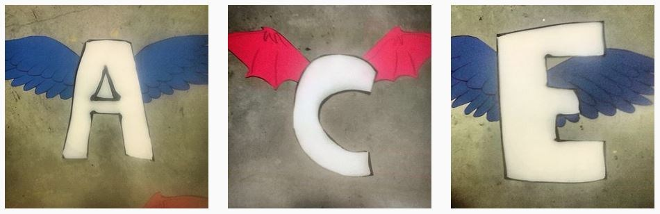 The letters A, C, and E, each of which adorned with bird or dragon wings.