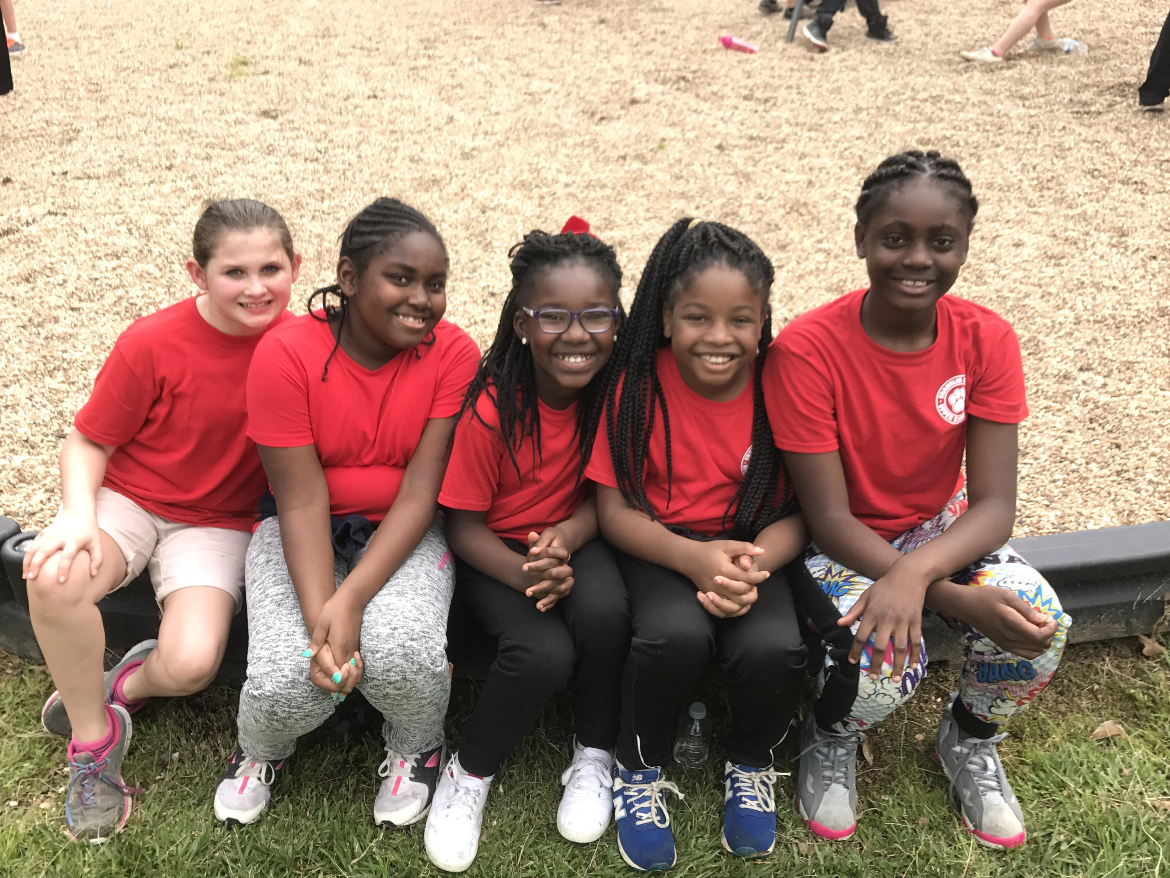 Red Pack girls on playground