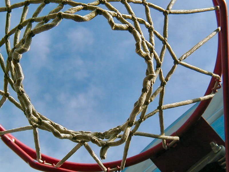 Photo looking up through a basketball hoop